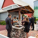 guests gathered around the fire pite outside our reception hall, barn, and silo