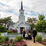 guests entering into our wedding chapel on a beautiful summer day for a ceremony