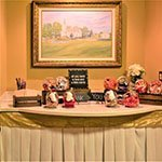 cake, gift, or snack table with chapel in the pines painting