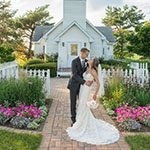 Couple embracing in front of our weddin chapel