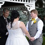couple holding hands in front of our wedding gazebo during our ceremony