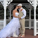 small photo of our newly married couple kissing in front of our weddign gazebo