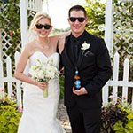 sunglasses on this couple in front of one of our many ivy covered trellis