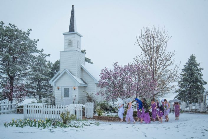 Bridal party making their way into the chapel during a winter wedding. Fall & Winter Photo Gallery