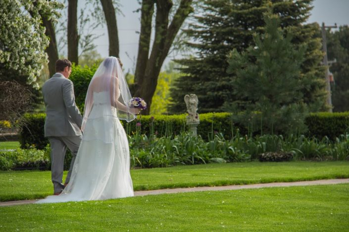 Newly married couple walking through our gardens after their ceremony.