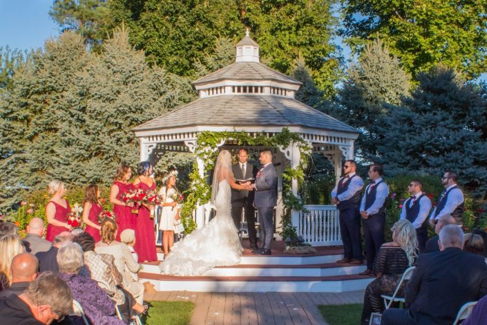 Gazebo Garden wedding ceremony on a sunny day.