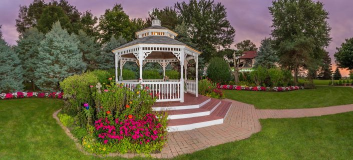 colorful flowers surrounding our white wedding gazebo.