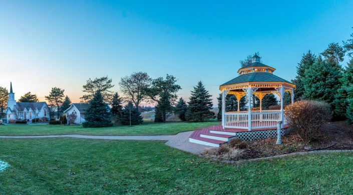 Gazebo, Chapel, and Cottage at dusk in the early spring before flowers have bloomed.