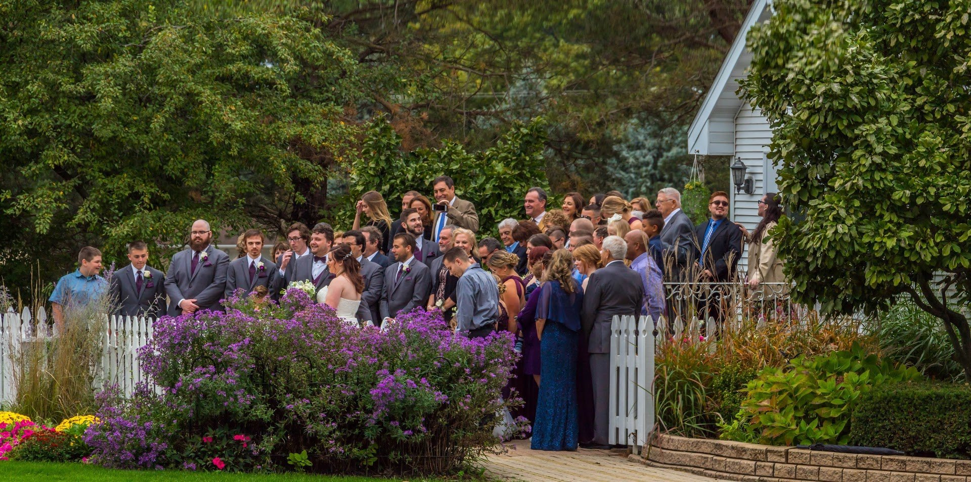 The whole wedding party and all the guests gather at our chapel from a large group photo. Instagram Gallery