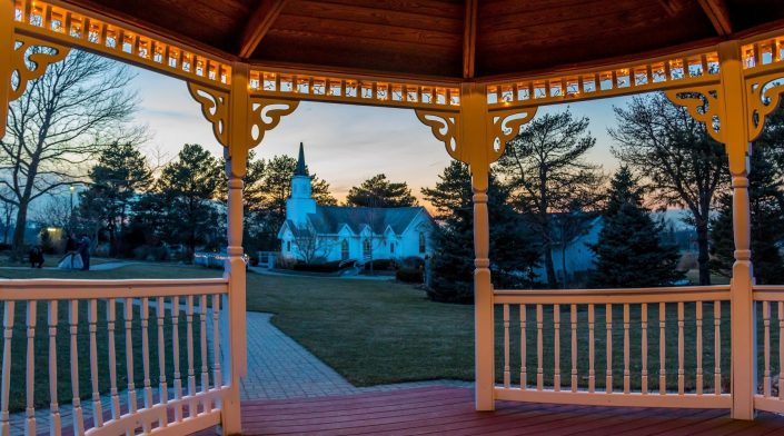 View of the Victorian inspired Chapel from the inside Gazebo at dusk. Instagram Galllery
