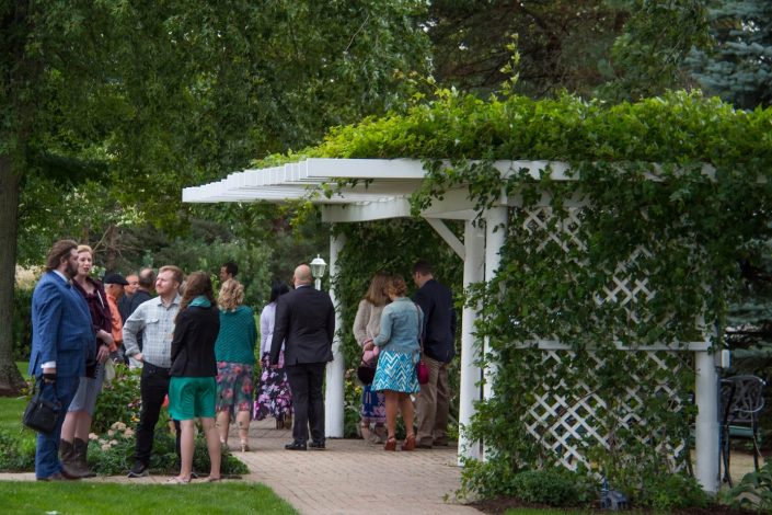 Many guests gathering in our gardens waiting for the wedding ceremony to begin.