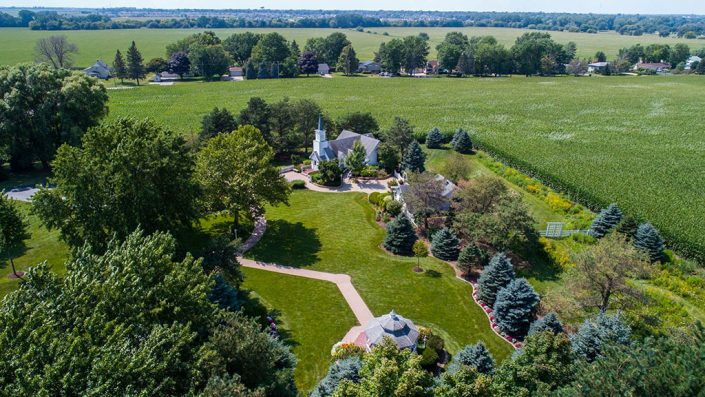 high up aerial drone view of chapel, grounds, gardens and gazebo