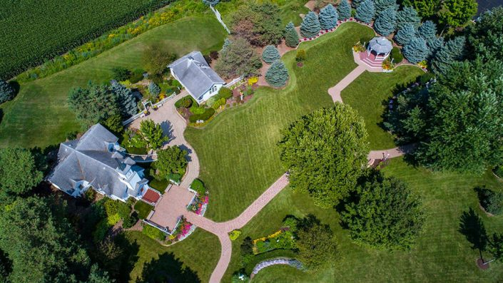 high up overhead aerial drone view of chapel, grounds, gardens and gazebo