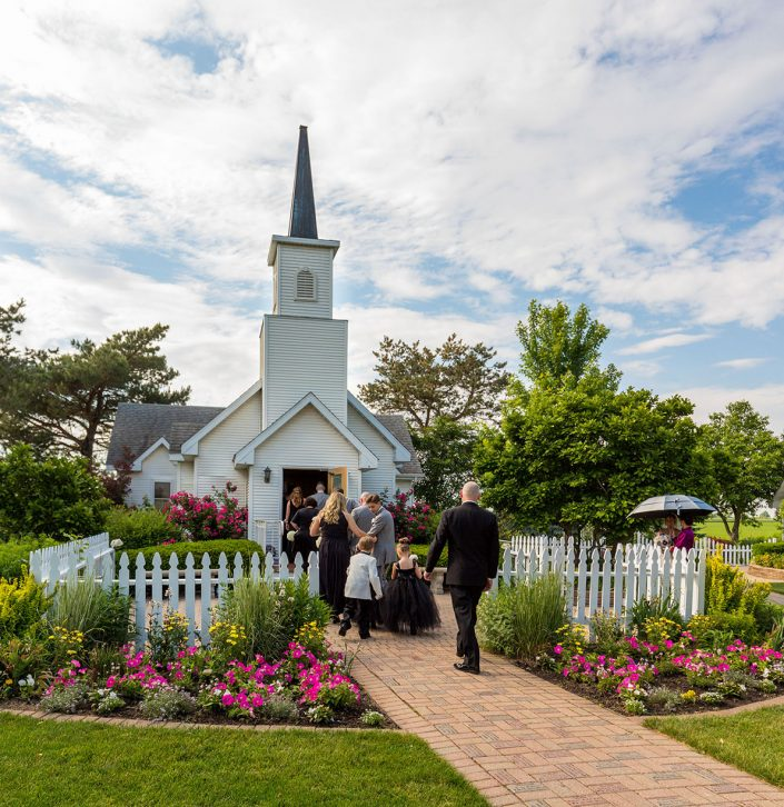 guests walking into the chapel from our garden path on a beautiful summer day