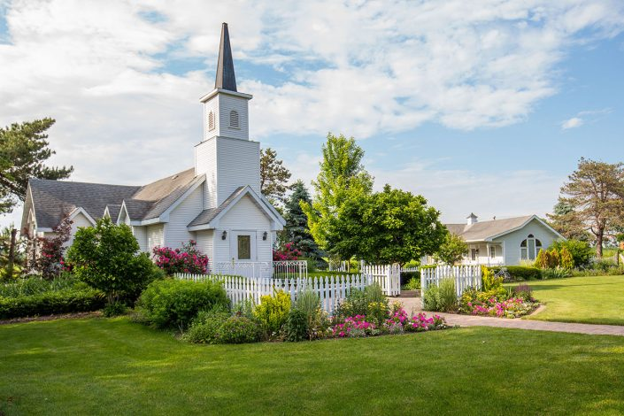 our lush green grass and gardens filled with colorful flowers surround our chapel and bridal cottage