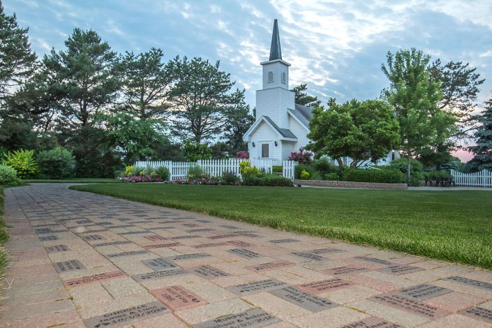 view at dusk of our Couple's Personalized Engraved Bricks path filled with our couples names and dates leading to our chapel
