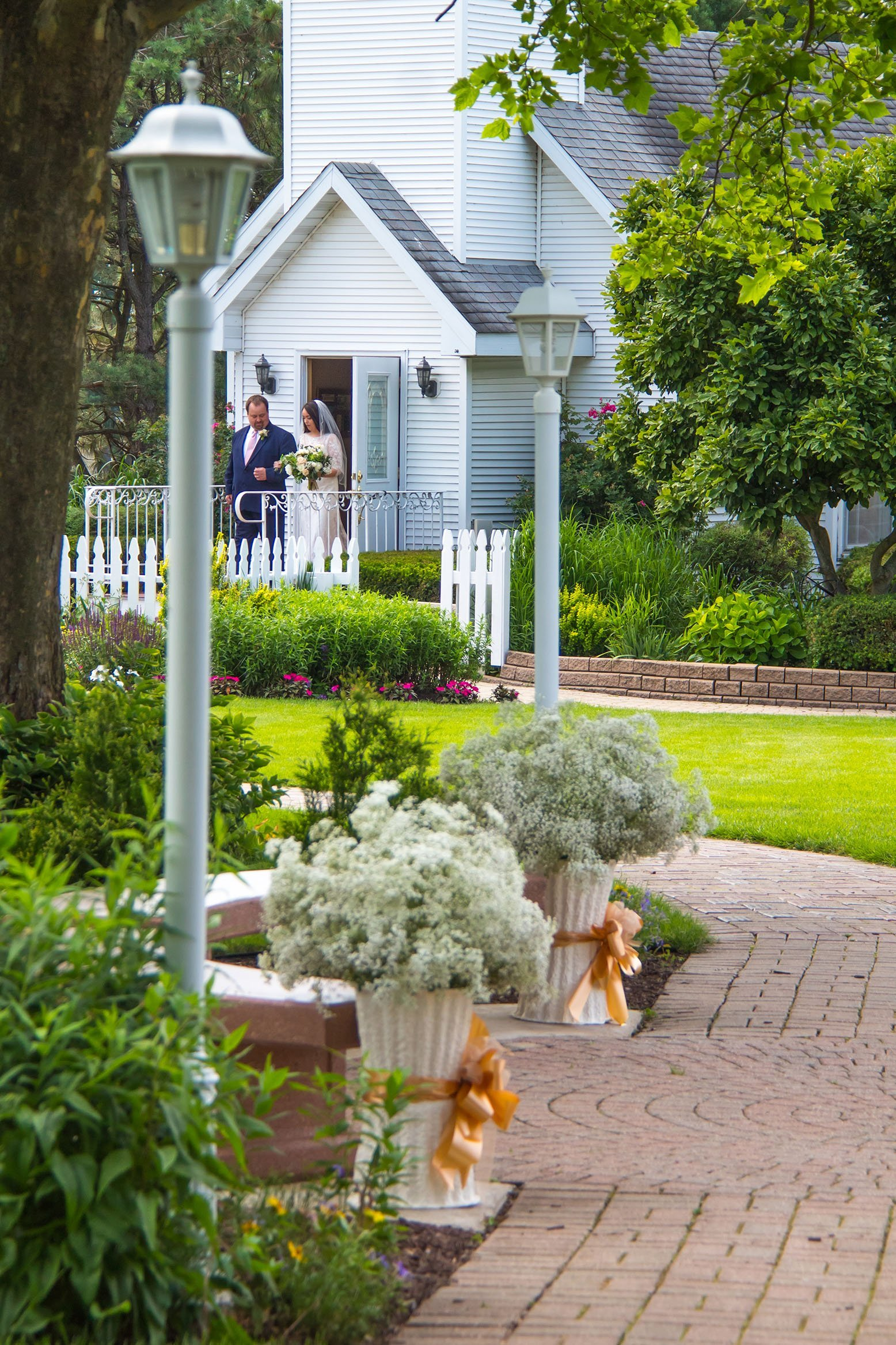 During a gazebo wedding ceremony the bridal party exits our chapel & walks down our engraved brick path.