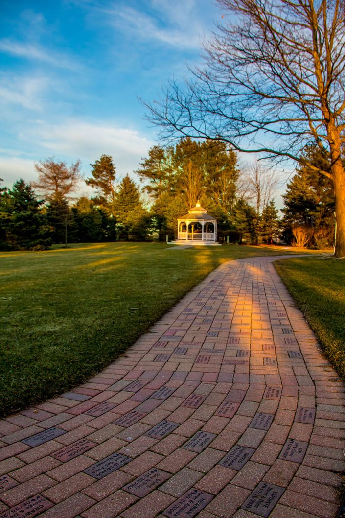 view at dusk of our engraved brick path to our gazebo in the fall