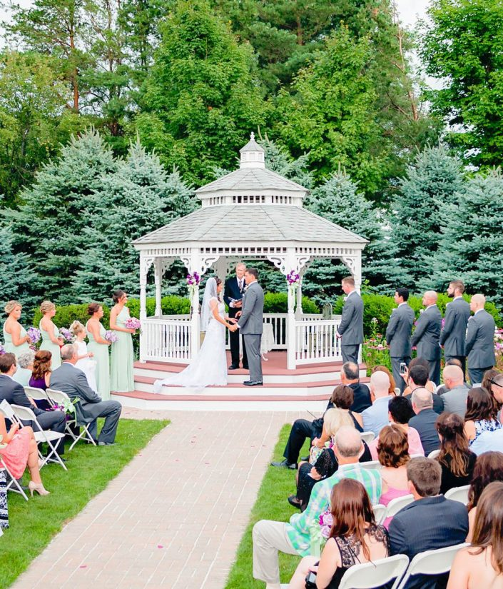 view of a wedding ceremony at chapel in the pines gazebo