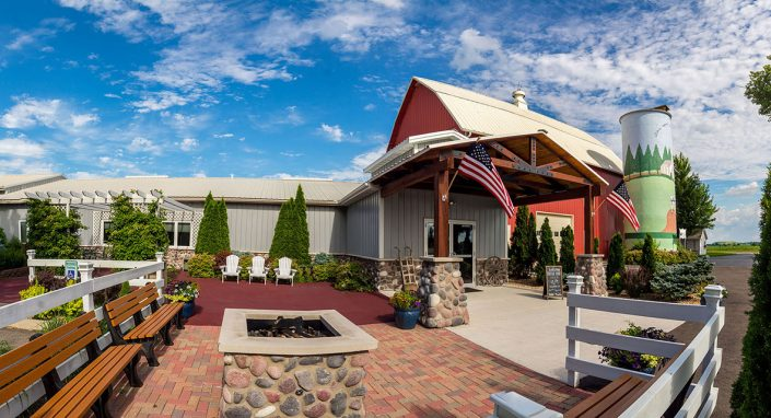 view of the fire pit, outdoor seating, barn, silo, and wedding reception banquet hall