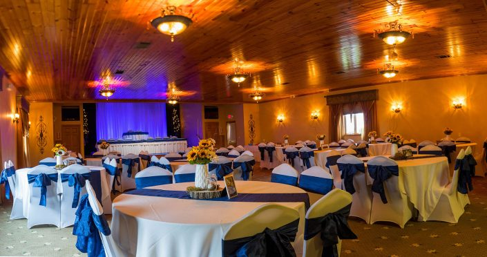 view of our banquet hall decorated in navy blue sashes for evening reception