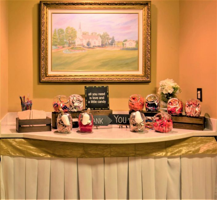 view of the cake, gift, or snack table with chapel in the pines painting