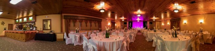 Long panorama of a decorated reception banquet hall and stocked bar
