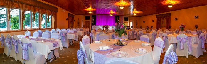 long panorama of a purple decorated wedding reception in our banquet hall