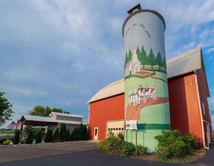 banquet hall entrance, red barn and freshly painted silo