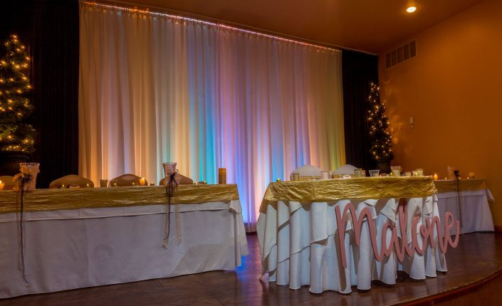 head table and rainbow curtain on our reception hall stage.