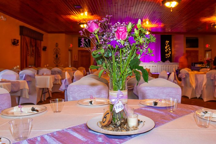 purple flower arrangment and decorations for the wedding reception in our banquet hall