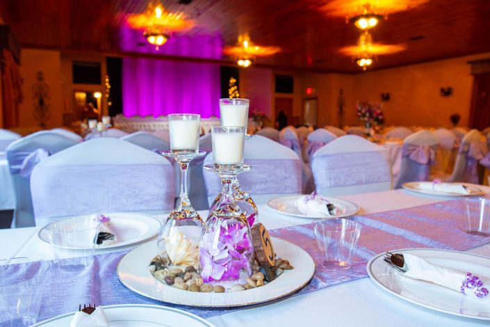 purple lights, decorations, and sashes on our tables in our banquet hall