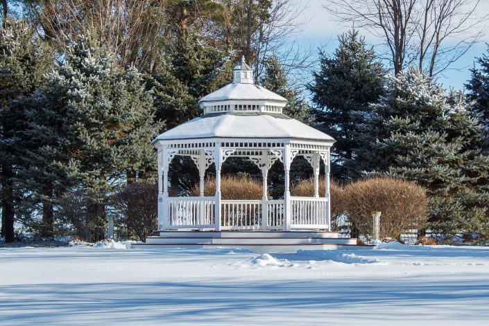 winter at chapel in the pines with snow covered gardens and gazebo
