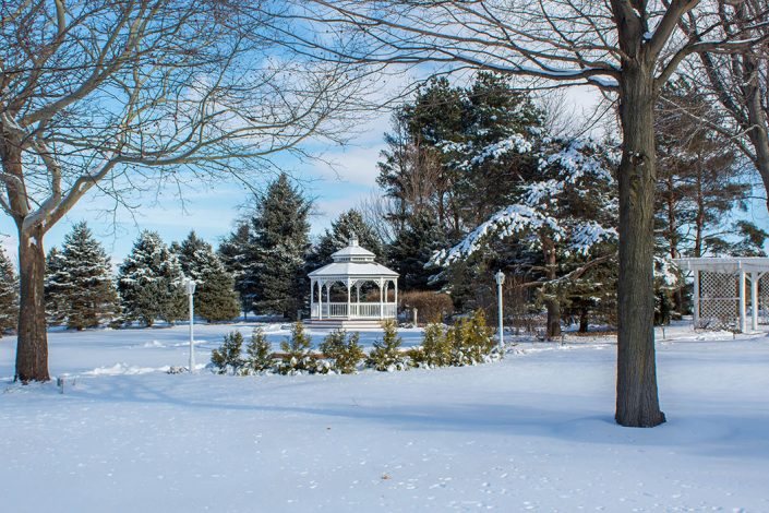 winter time at chapel in the pines gazebo and gardens covered in snow