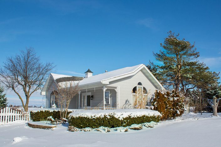 winter at chapel in the pines with snow covered bridal cottage