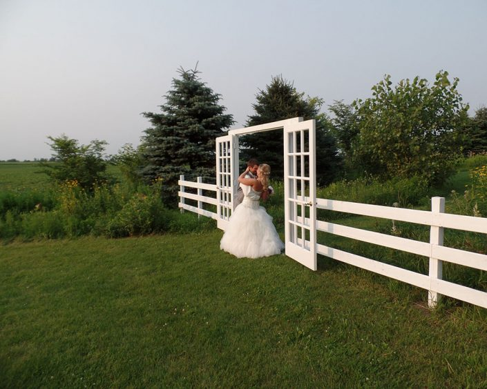 couple kissing in front of our field doorway