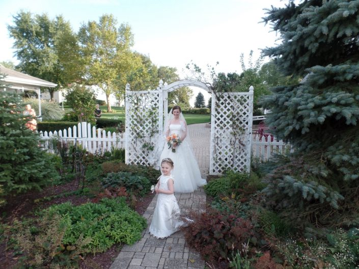 bride and flower girl in our garden path