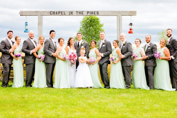 chapel in the pines field fence with full bridal party