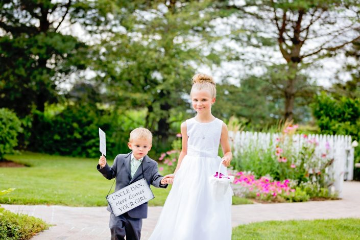 flower girl and ring bearer walking to the ceremony