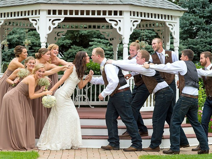 Bridal party keeping the newly married couple from keeping in front of our Garden Gazebo.