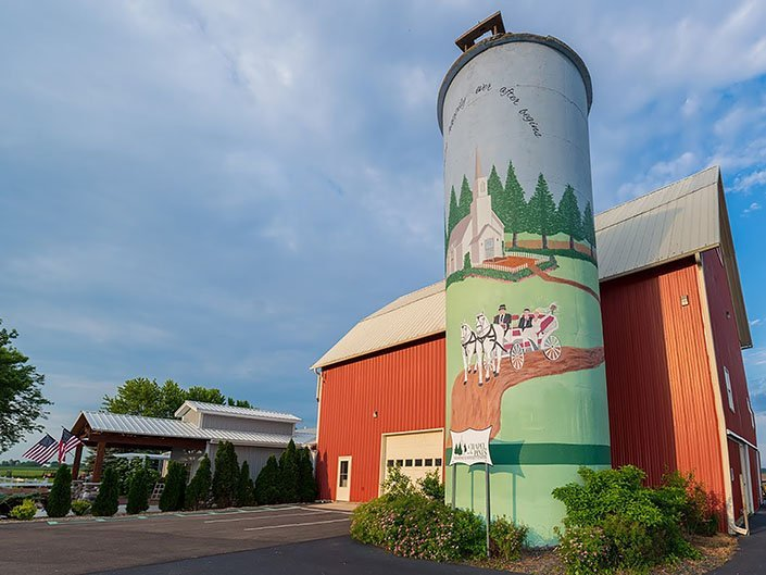 Our red barn and freshly painted silo sit right next to the entrance of our wedding reception hall.