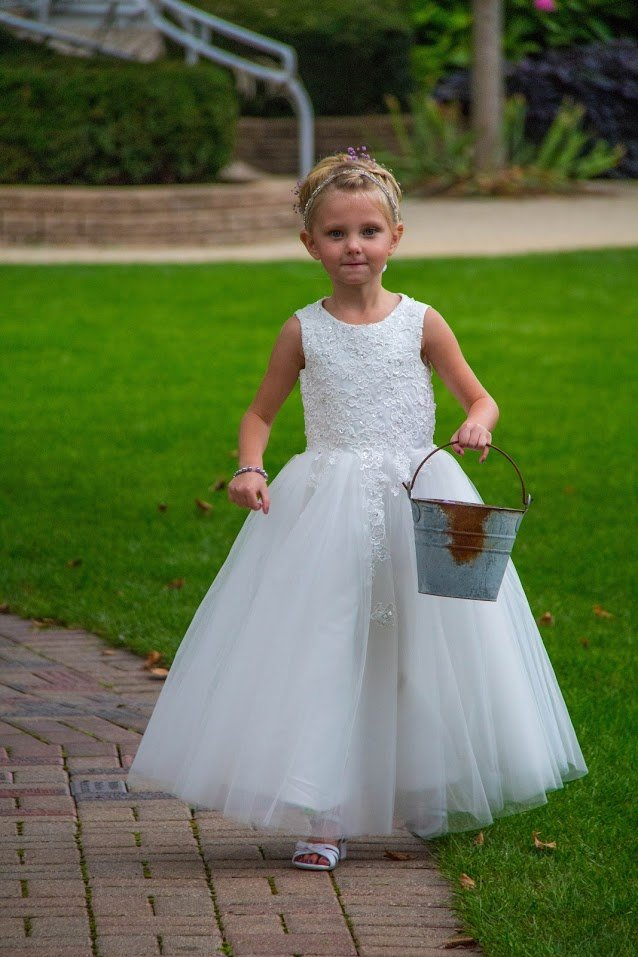 Flower girl walking down our engraved brick path to a garden gazebo ceremony.